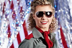 Pin-up army woman  standing near the American flag Royalty Free Stock Images