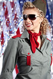Pin-up army woman  standing near the American flag Royalty Free Stock Photography
