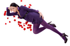Pin-up attractive brunette lie on floor with rose Royalty Free Stock Image