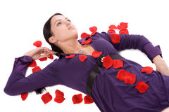 Pin-up attractive brunette lie on floor with rose Royalty Free Stock Photo