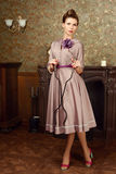 Pin Up beautiful young woman in vintage interior Stock Photography