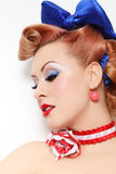 Pin-up beauty. Portrait of beautiful young sexy pin-up girl with sparkly make-up and vintage hairstyle, over white wall Stock Photos