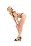 Pin-up blond in platform shoes and black bikini Stock Images