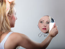 Pin up blonde fashion girl looking at mirror Stock Images