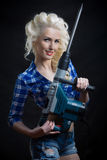 Pin-up blonde with industrial hammer. Royalty Free Stock Photos