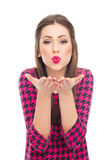 Pin-up blowing kisses at camera Royalty Free Stock Photo