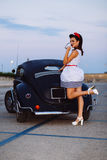 Pin-up at blue hour with custom car Royalty Free Stock Photo