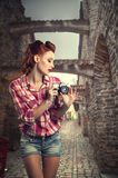 Pin-up with a camera. Royalty Free Stock Image