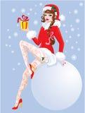 Pin Up Christmas Girl moreno que lleva a Santa Claus Foto de archivo