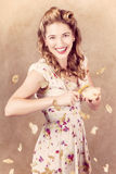 Pin-up cooking girl peeling potato. Quick recipe Royalty Free Stock Photography