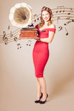 Pin-up at the disco. Vintage woman with gramophone Stock Image