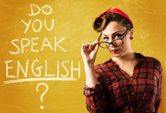 Pin-up english teacher. Woman pin-up style with eyeglasses and blackboard royalty free stock photo