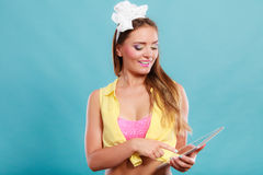 Pin up fashion girl browsing internet on pc tablet Stock Photo