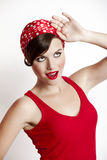Pin-up girl. Beautiful and fashion young woman with a pin-up look Royalty Free Stock Photography