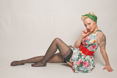 Pin up girl. Beautiful pin-up girl in 1950's dress and underwear stock photos