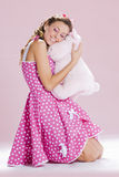 Pin-up girl. A beautiful inocent pin-up girl over a pink background Royalty Free Stock Photos