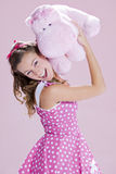 Pin-up girl. A beautiful inocent pin-up girl over a pink background Royalty Free Stock Image