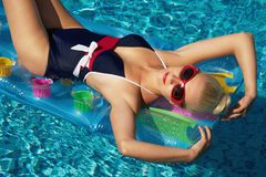 Pin up girl. In the swimming pool Stock Photo