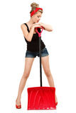 Pin-up girl. Classic sexy pin-up girl in shorts with red snow shovel Royalty Free Stock Photos