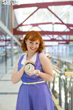 Pin-up girl with an alarm clock in his hands Royalty Free Stock Photos