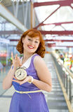 Pin-up girl with an alarm clock in his hands Stock Photo