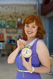 Pin-up girl with an alarm clock in his hands Stock Images