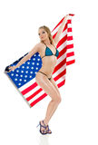 Pin-Up girl with american flag Stock Photography