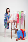 Pin-up girl. American style. Dress and white stockings Stock Photo