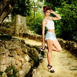 Pin-up girl. American style, in a garden Royalty Free Stock Images