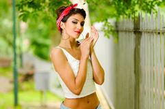 Pin-up girl. American style, in a garden Royalty Free Stock Photography