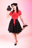 Pin-up girl American style retro woman camera Royalty Free Stock Photo
