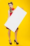 Pin-up girl in american style. Showing blank signboard stock photo