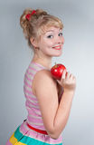 Pin-up girl with apple Stock Photo