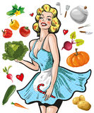Pin up girl in an apron with vegetables cooking concept Stock Photo