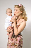 Pin-up girl with baby Royalty Free Stock Images