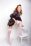 Pin up girl. beautiful caucasian woman in a black stock photography