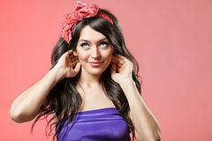 Pin up girl with beautiful hair. On a pink background Royalty Free Stock Image