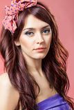 Pin up girl with beautiful hair. On a pink background Stock Image