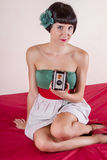 Pin-up girl in bed. View of a pin-up girl in bed with small retro camera stock images