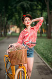 Pin-up girl on bicycle, vintage american fashion royalty free stock photography