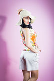 Pin up girl in a big hat Stock Photo