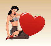 Pin-up girl with big heart Stock Photo