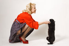 Pin-up girl with black cat stock photography