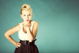 Pin up girl blowing a kiss - flirty. Retro style. Pin up blonde cute girl blowing a kiss on blue background Stock Photo