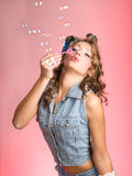 Pin-up girl and blows bubbles Royalty Free Stock Image