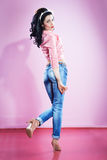 Pin up girl in blue jeans Stock Photography