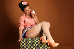 Pin up girl with cake Royalty Free Stock Photography