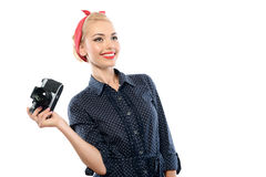 Pin up girl with a camera Stock Images