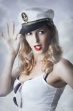Pin-up girl in captain cap Stock Image
