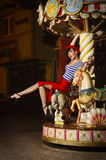 Pin Up Girl and carousel Stock Photography